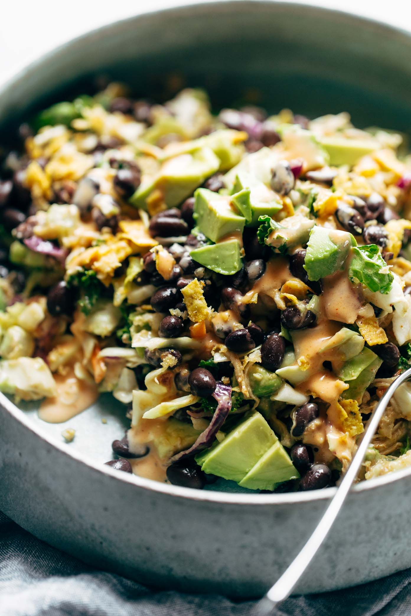 Cheater's Power Salad - kale, cabbage, avocado, green onion, cilantro, black beans, crispy onions, tortilla strips, chicken, and BBQ ranch dressing, made from a salad mix! I KNOW. perfect for easy lunches! | pinchofyum.com
