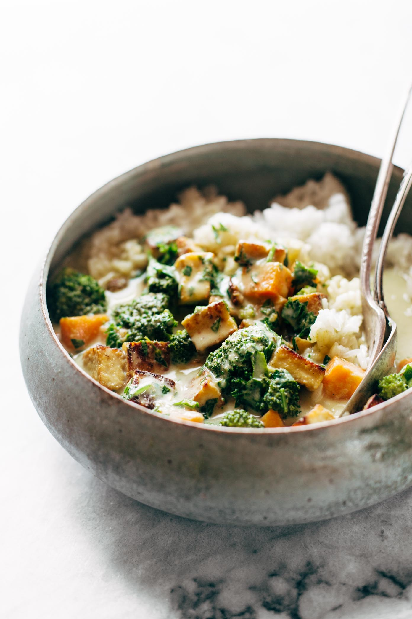 5-Ingredient Green Curry! packed with tons of veggies, an easy green curry sauce, and finished with golden raisins and cilantro. Easy!   pinchofyum.com
